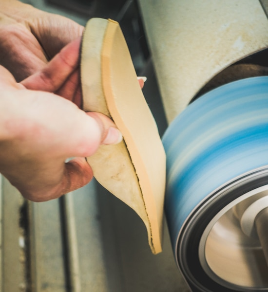 adjusting an orthotics sole by sanding